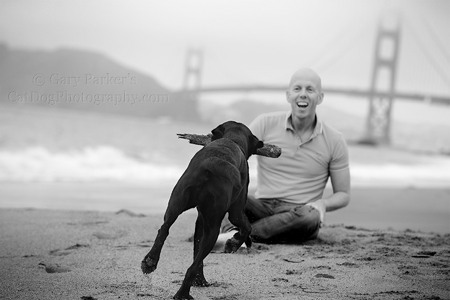 MICKEY, A THERAPY DOG, RUNS TO ARJAN, HIS HUMAN, AS FOG ENSHROUDS THE GOLDEN GATE BRIDGE...